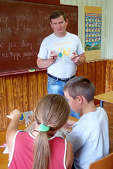 Sergei teaching children at Sunday school.