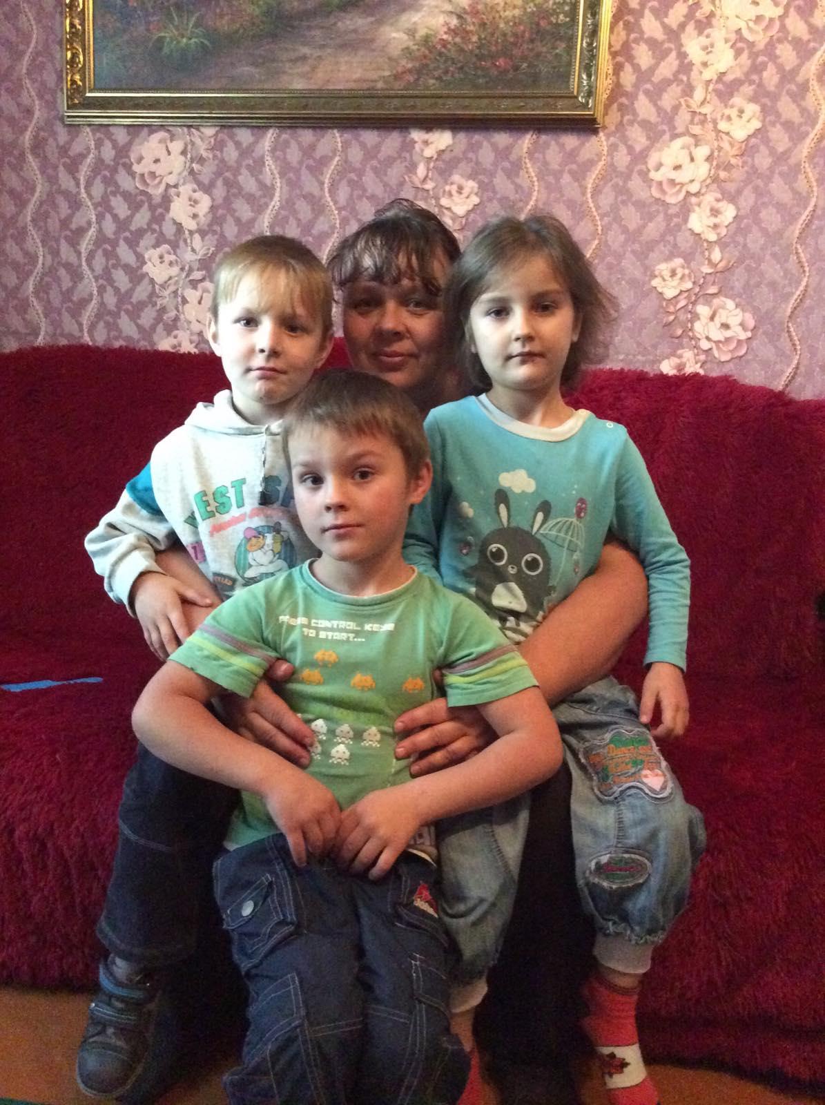 Tamara with Nikita, Kseniya, and Yura.