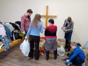 Giving clothing to families in need.