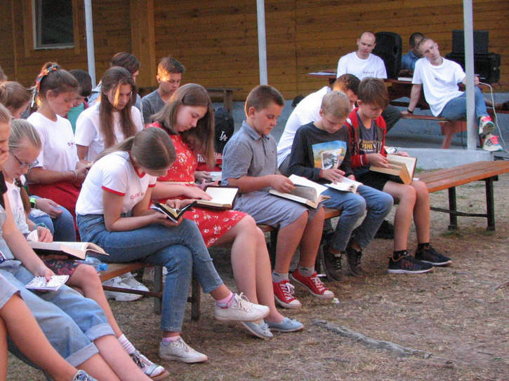 Children study God's Word during a Bible lesson.