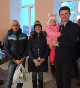 Pastor Andrei with Katerina and her family.