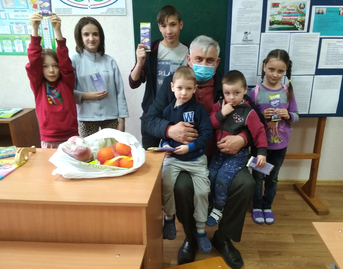 Sergei with Polina and other children in her orphanage.
